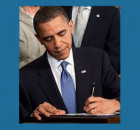 Obama signing healthcare bill