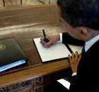 1024px-Barack_Obama_signs_at_his_desk
