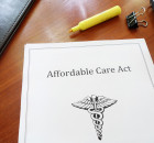 Affordable Care Act document on an office desk
