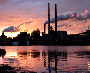 landscape photo of factory whith smoke stacks